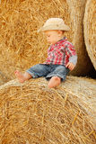Little boy playing in a cowboy hat Royalty Free Stock Photography