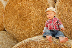 Little boy playing in a cowboy hat Stock Photos