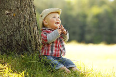 Little boy playing cowboy in nature Royalty Free Stock Images
