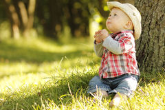 Little boy playing cowboy in nature Stock Photos