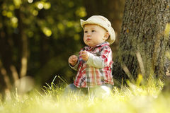 Little boy playing cowboy in nature Stock Photo