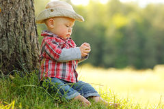 Little boy playing cowboy in nature Royalty Free Stock Image
