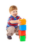 Little boy playing with cubes Stock Image