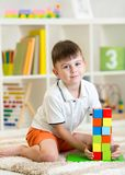 Little boy playing with cubes Stock Photography