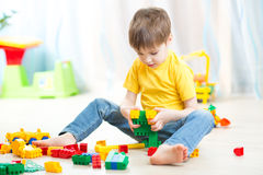 Little boy playing with cubes Stock Images
