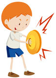 Little boy playing cymbals Stock Photo