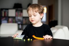 Little boy playing with medicines Stock Photo