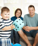 Little boy playing with die stock photography