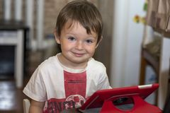 Little boy playing with digital tablet. kid using a digital tablet royalty free stock image