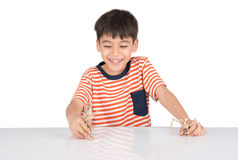 Little boy playing dinosaur fossil toy on the table indoor activities Royalty Free Stock Photo