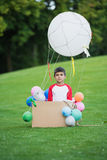 Little boy playing with diy hot air balloon in park Royalty Free Stock Photography