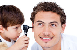 Little boy playing with the doctor Stock Image