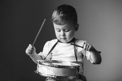 Little boy playing the drum. Child development concept. stock photo