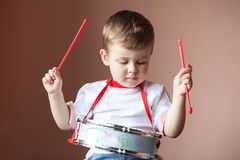 Little boy playing the drum. Child development concept. royalty free stock photography