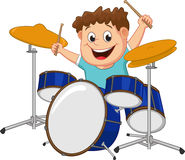 Little boy playing drum Stock Images