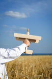 Little boy playing in farmland with a toy airplane Royalty Free Stock Image