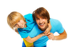 Little boy playing with father Stock Images