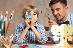Little boy playing with father Stock Image