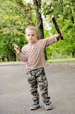 Little boy playing with fighting sticks Royalty Free Stock Photos