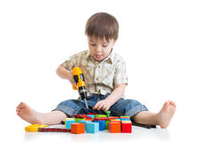 Little boy playing on floor Royalty Free Stock Image