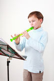 Little boy playing flute Royalty Free Stock Images