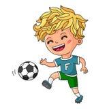 Little boy playing football Stock Photos