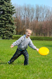 Little boy is playing Frisbee Stock Images