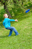 Little boy playing frisbee Stock Image