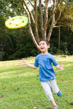Little boy playing Frisbee Royalty Free Stock Images