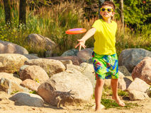 Little boy playing with frisbee disc. Royalty Free Stock Images