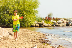 Little boy playing with frisbee disc. Royalty Free Stock Photos