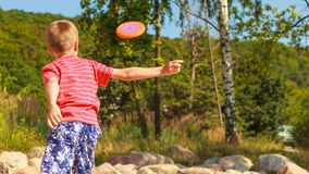 Little boy playing with frisbee disc. Royalty Free Stock Image