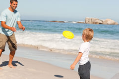 Little boy playing frisbee with his father Royalty Free Stock Photo