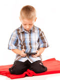 Little boy playing games on smartphone Royalty Free Stock Image