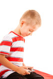 Little boy playing games on smartphone Stock Image
