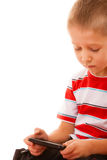 Little boy playing games on smartphone Royalty Free Stock Photography