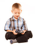 Little boy playing games on smartphone Stock Photo