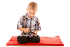 Little boy playing games on smartphone Royalty Free Stock Photos