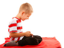 Little boy playing games on smartphone Royalty Free Stock Photo