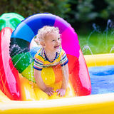 Little boy playing in garden swimming pool Royalty Free Stock Photo