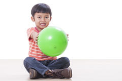 Little boy playing green ball Royalty Free Stock Images
