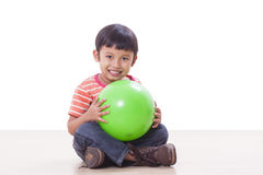 Little boy playing green ball Stock Photography
