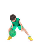 Little boy playing green basketball in green PE uniform sport Royalty Free Stock Images