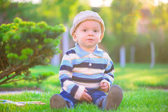 Little boy playing on green grass Stock Photography