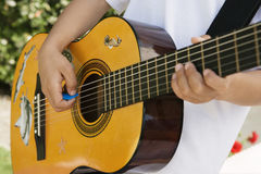 Little Boy Playing Guitar Royalty Free Stock Image