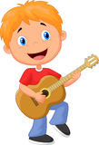 Little boy playing guitar Royalty Free Stock Photo