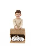 Little boy playing happily Stock Image