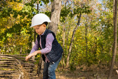 Little boy playing in a hardhat Royalty Free Stock Photography