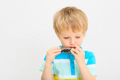 Little boy playing harmonica Royalty Free Stock Photography