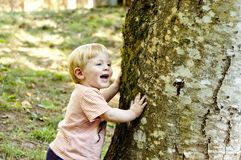 Little boy playing hide and seek Royalty Free Stock Photo